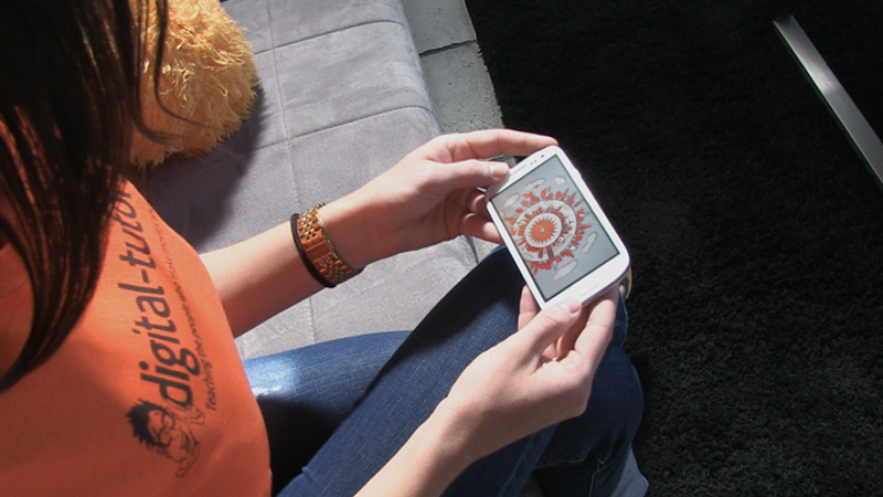girl playing a mobile game on her phone